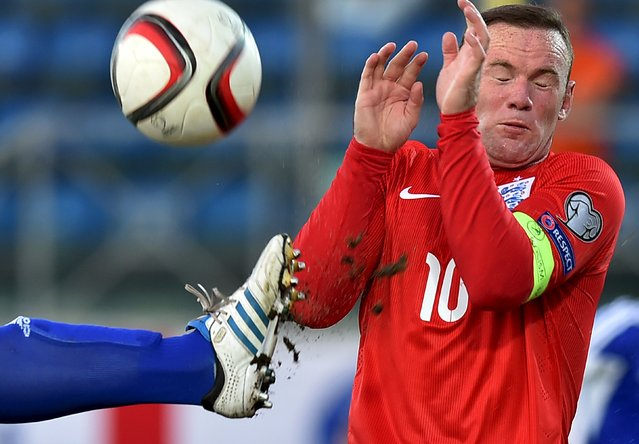 England's Wayne Rooney (R) covers himself during their Euro 2016 qualifying soccer match against San Marino at the Olympic stadium in Serravalle, San Marino, September 5, 2015. (Photo by Alberto Lingria/Reuters)