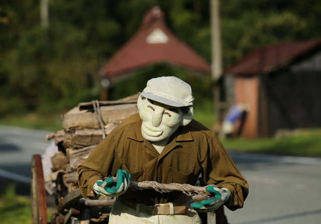 An illustration showing a scarecrow pulling a firewood cart beside a road is on display at Kakashi no Sato, or the Scarecrow's Hometown on September 10, 2014 in Himeji, Japan. (Photo by Buddhika Weerasinghe/Getty Images)