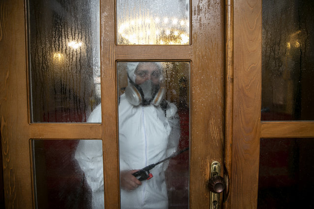 Disinfection team disinfect the premises of the grand mosque in capital Pristina, Kosovo on Thursday, May 28, 2020. Kosovo's mosques reopened on Thursday after more than two months of the virus lockdown. (Photo by Visar Kryeziu/AP Photo)