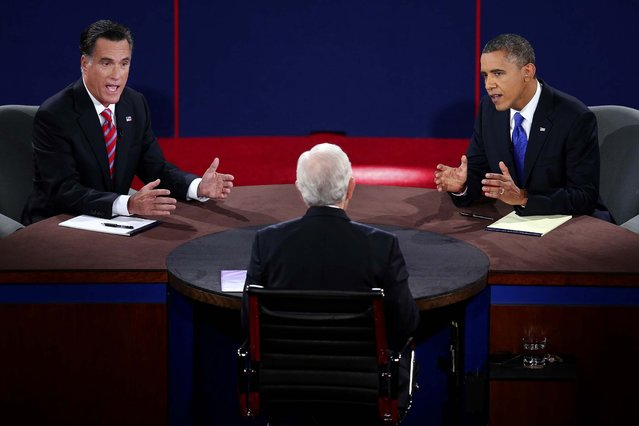Romney and Obama talk over each other as they are questioned by moderator Bob Schieffer. (Photo by Win McNamee/Associated Press)