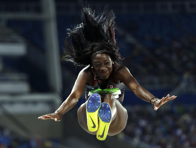 Canada's Christabel Nettey makes an attempt in the women's long jump qualification during the athletics competitions of the 2016 Summer Olympics at the Olympic stadium in Rio de Janeiro, Brazil, Tuesday, August 16, 2016. (Photo by Matt Slocum/AP Photo)