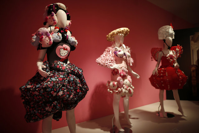"""Hello Kitty dresses are displayed at the """"Hello! Exploring the Supercute World of Hello Kitty"""" museum exhibit in honor of Hello Kitty's 40th anniversary, at the Japanese American National Museum in Los Angeles, California October 10, 2014. (Photo by Lucy Nicholson/Reuters)"""