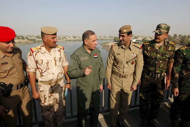 Iraqi Defence Minister Khaled al-Obeidi (C) speaks with officers during his visit to military cadets in Baghdad, September 22, 2015. (Photo by Ahmed Saad/Reuters)