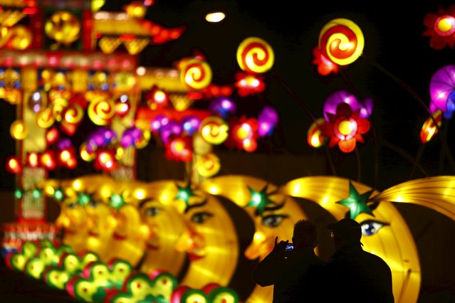 People take photos while attending the Dandenong Festival of Lights in the suburb of Dandenong in Melbourne, Australia, September 23, 2015. The month-long festival, set up by the Chinese Cultural Works Light Spectacular, celebrates Chinese culture through a display of hundreds of beautiful and unique silk light displays, according to the event's website. (Photo by Darrin Zammit Lupi/Reuters)