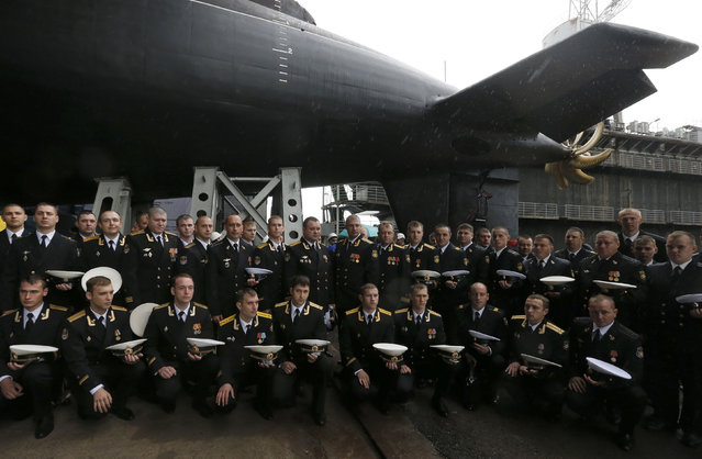 "Crew members pose for a picture during a ceremony launching the diesel-electric submarine ""Rostov-on-Don"" at the Admiralty Shipyards in St. Petersburg, June 26, 2014. (Photo by Alexander Demianchuk/Reuters)"