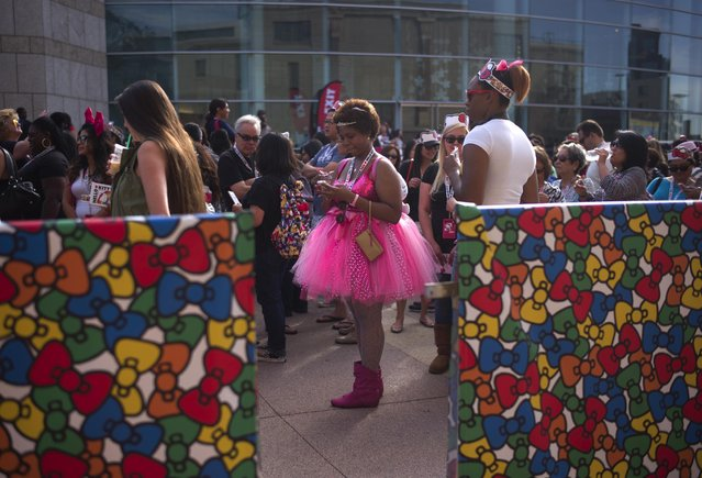 Nicole Michel, center, of Fontana, Calif., waits in line to attend the Hello Kitty Con, the first-ever Hello Kitty fan convention, held at the Geffen Contemporary at MOCA Thursday, October 30, 2014, in Los Angeles. (Photo by Jae C. Hong/AP Photo)