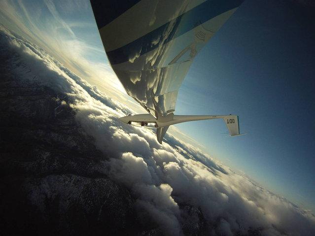 """Flying the Wave by Gordon Boettger. Soaring high above the Sierra Nevada near Heavenly Valley Ski area"". (Photo by Gordon Boettger)"