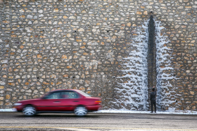 Water on retaining wall iced up due to the freezing cold, during winter in Van, Turkey on January 11, 2018. (Photo by Ozkan Bilgin/Anadolu Agency/Getty Images)