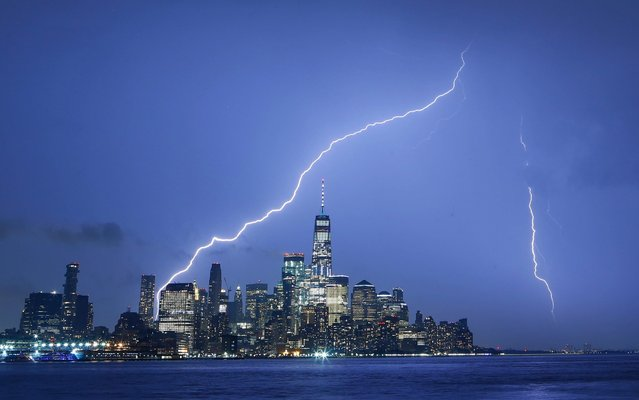 Lightning strikes on either side of One World Trade Center in lower Manhattan in New York City on May 28, 2019 as seen from Hoboken, New Jersey. (Photo by Gary Hershorn/Getty Images)