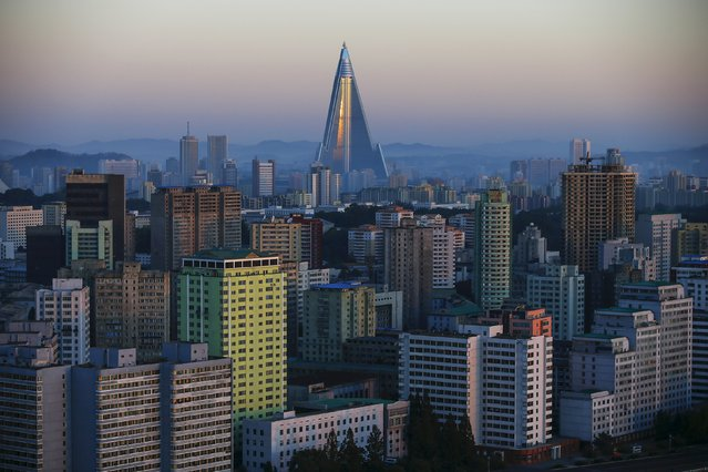The 105-storey Ryugyong Hotel, the highest building under construction in North Korea, is seen behind residential buildings in Pyongyang, North Korea, early October 9, 2015. (Photo by Damir Sagolj/Reuters)