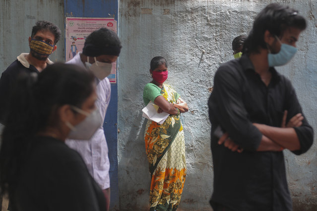 People wait to give their nasal swab samples to test for COVID-19 in Hyderabad, India, Friday, August 28, 2020. India has the third-highest coronavirus caseload after the United States and Brazil, and the fourth-highest death toll in the world. (Photo by Mahesh Kumar A./AP Photo)