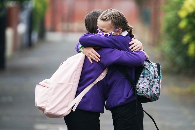 Kadie Lane (right), 11, and Brooke Howourth, 11, walking to Marden Bridge Middle School in Whitley Bay, Tyne and Wear, UK for their first day of term on September 2, 2020, as schools in England reopen to pupils following the coronavirus lockdown. (Photo by Owen Humphreys/PA Images via Getty Images)