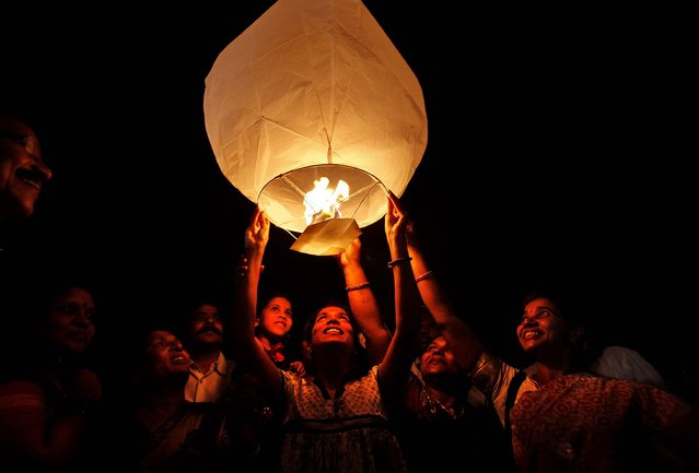 Activists of the All India Peace and Solidarity Organization release a sky lantern on International Women's Day in Hyderabad, India. (Photo by Mahesh Kumar A./Associated Press)