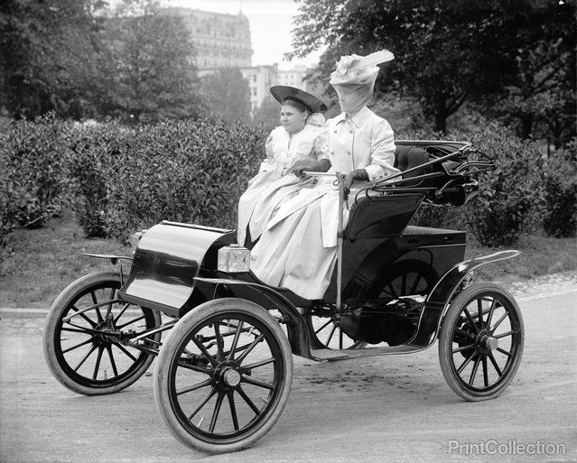 Two Women driving (posing) in a car around 1910. Photographed by Harris & Ewing.