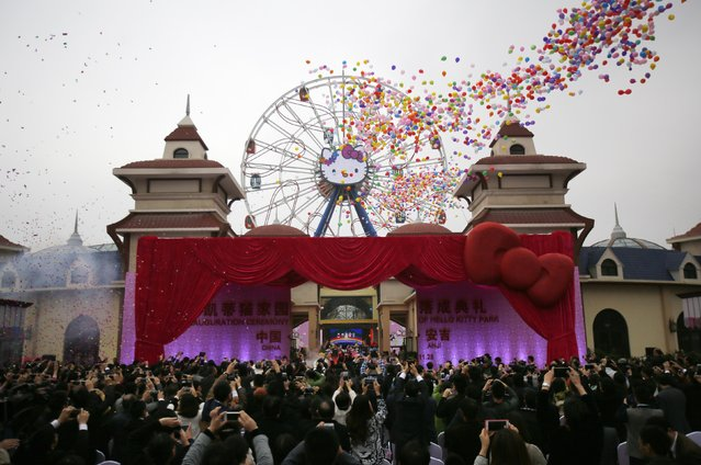 Guests attend an inauguration ceremony of a Hello Kitty amusement park in Anji, Zhejiang province November 28, 2014. (Photo by Carlos Barria/Reuters)