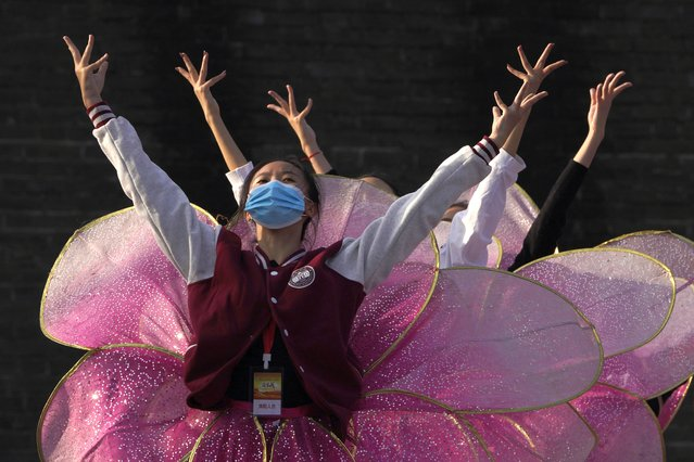 Performers wearing masks to protect from the coronavirus rehearse for a show at the Badaling Great Wall of China on the outskirts of Beijing on Tuesday, October 6, 2020. (Photo by Ng Han Guan/AP Photo)