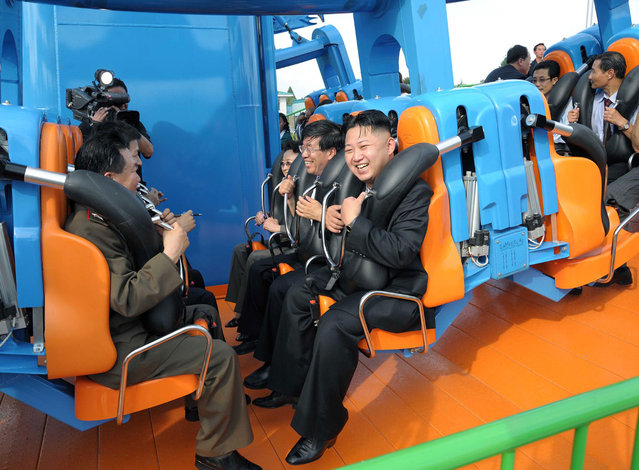 North Korean leader Kim Jong-Un prepares to take a ride with other high-level officials during the opening ceremony of the Rungna People's Pleasure Ground along the Taedong River in Pyongyang, on July 25, 2012. (Photo by Reuters/KCNA)
