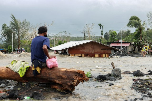 A man looks as floodwaters inundate an area as Typhoon Goni hit Daraga, Albay province, central Philippines, Sunday, November 1, 2020. (Photo by Nino N. Luces/Reuters)