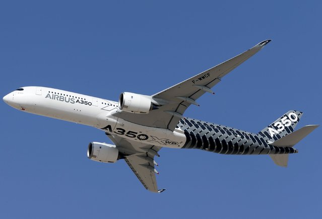 An Airbus A350 performs a flypast during the Dubai Airshow November 8, 2015. (Photo by Ahmed Jadallah/Reuters)