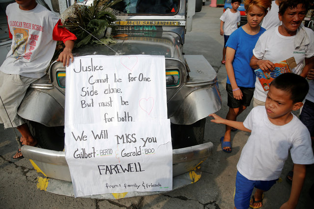 Friends and relatives follow vehicles with coffins of two cousins killed by masked gunmen to a cemetery in Manila, Philippines October 11, 2016. (Photo by Damir Sagolj/Reuters)