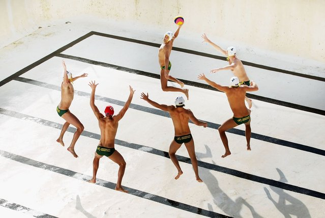The Australian Mens Olympic Waterpolo Team are photographed in an empty Bondi Icebergs pool at Bondi Beach on May 31, 2012 in Sydney, Australia. The Aussie Sharks as they are known were finalizing their preparations for the 2012 London Olympic Games when I asked them to pose in an famous ocean pool... with the twist of it being empty. (Photo by Ryan Pierse/2013 Sony World Photography Awards)