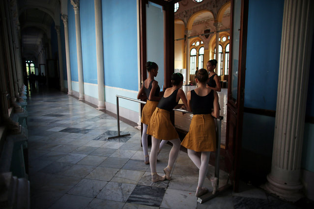 Students at the Cuba's National Ballet School (ENB) chat during a break in Havana, Cuba, October 12, 2016. (Photo by Alexandre Meneghini/Reuters)