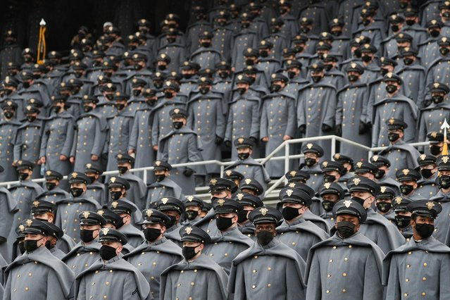 """U.S. Army cadets wearing protective masks with the message """"Beat Navy"""" stand at Michie Stadium ahead of the annual Army-Navy collegiate football game, in West Point, New York, U.S., December 12, 2020. (Photo by Tom Brenner/Reuters)"""
