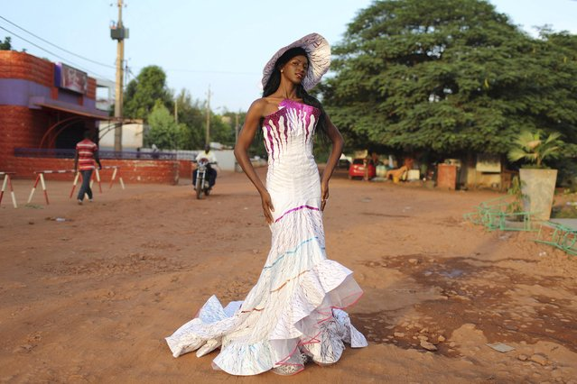 Model Sira Coulibaly poses for a picture in bazin outfits made by designer Fall Creation in Bamako, Mali, October 21, 2015. (Photo by Joe Penney/Reuters)