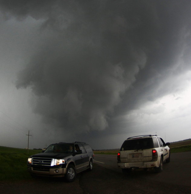 Storm chasers get close to a tornadic thunderstorm, one of several tornadoes that touched down, in South Haven, Kansas, May 19, 2013. (Photo by Gene Blevins/Reuters)