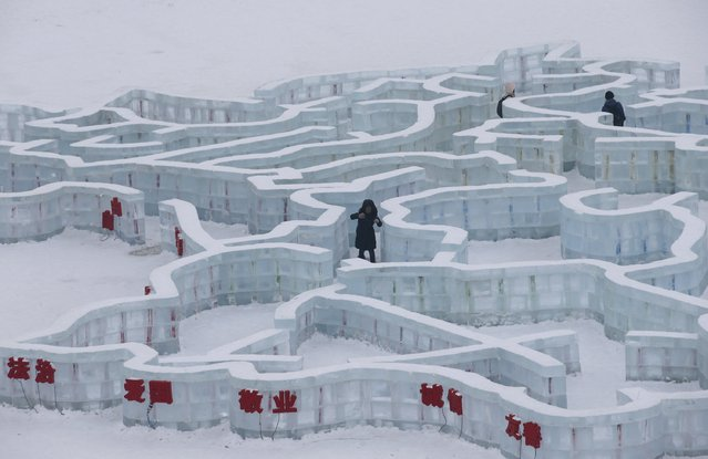 A visitor makes her way in a maze which is made by ice bricks ahead of the 31st Harbin International Ice and Snow Festival in the northern city of Harbin, Heilongjiang province, January 4, 2015. (Photo by Kim Kyung-Hoon/Reuters)
