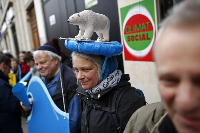 A woman with a polar bear hat participates in a human chain to show solidarity for climate change after the cancellation of a planned climate march following shootings in the French capital, ahead of the World Climate Change Conference 2015 (COP21), in Paris, France, November 29, 2015. (Photo by Benoit Tessier/Reuters)