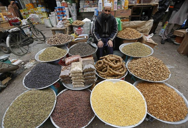 An Afghan man waits for customers at a dried fruit market in Kabul January 12, 2015. (Photo by Omar Sobhani/Reuters)