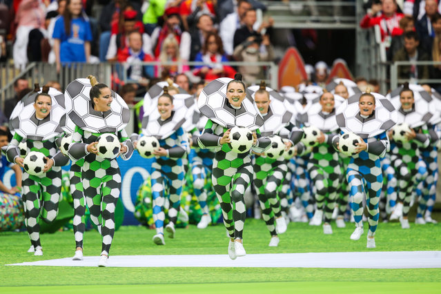 Performers take to the pitch during the opening ceremony before the Russia 2018 World Cup Group A football match between Russia and Saudi Arabia at the Luzhniki Stadium in Moscow on June 14, 2018. (Photo by Sergei Bobylev/TASS via Getty Images)