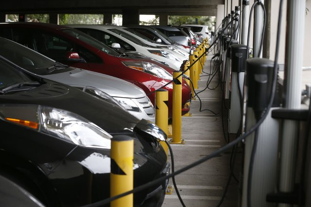 "Electric cars sit charging in a parking garage at the University of California, Irvine January 26, 2015. ""The Irvine Smart Grid Demonstration"", a $79 million project funded half by federal stimulus money and half by Edison and partners like UC Irvine, was launched in 2010. (Photo by Lucy Nicholson/Reuters)"