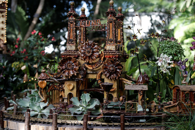 A model train travels past a scaled model of the former Luna Park at Coney Island built entirely with plant parts during a media preview of the 25th annual Holiday Train Show at the New York Botanical Garden in the Bronx borough of New York City, U.S., November 14, 2016. (Photo by Mike Segar/Reuters)