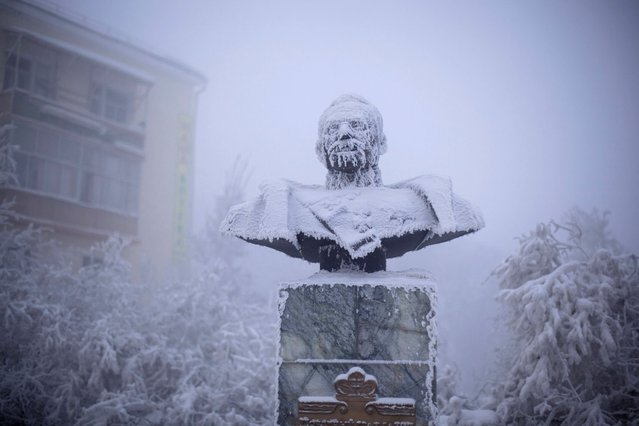 A statue of Ivan Kraft, one of the first governors of the republic of Yakutia, in Yakutsk, Russia, January 2014. (Photo by Amos Chapple/REX Features)