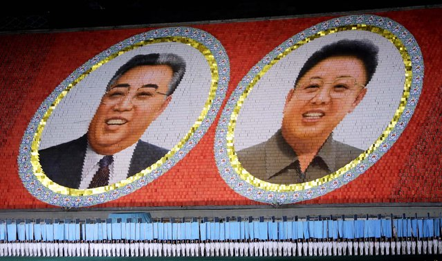 "North Korean students use different colored cardboard to form portraits of late North Korean leaders Kim Jong-il and Kim Il-sung (L) as background during a mass gymnastic and artistic performance ""Arirang"", in Pyongyang July 26, 2013, as part of celebrations ahead of the 60th anniversary of the signing of a truce in the 1950-1953 Korean War. (Photo by Jason Lee/Reuters)"