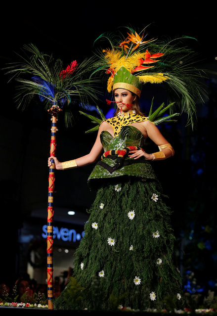 A model presents a creation during the Biofashion show, which features designs made from plants, recycled and natural materials, in Cali, Colombia, November 19, 2016. (Photo by Jaime Saldarriaga/Reuters)