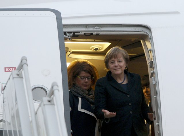 Germany's Chancellor Angela Merkel (front) walks out of a plane upon her arrival at an airport near Minsk, February 11, 2015. (Photo by Valentyn Ogirenko/Reuters)