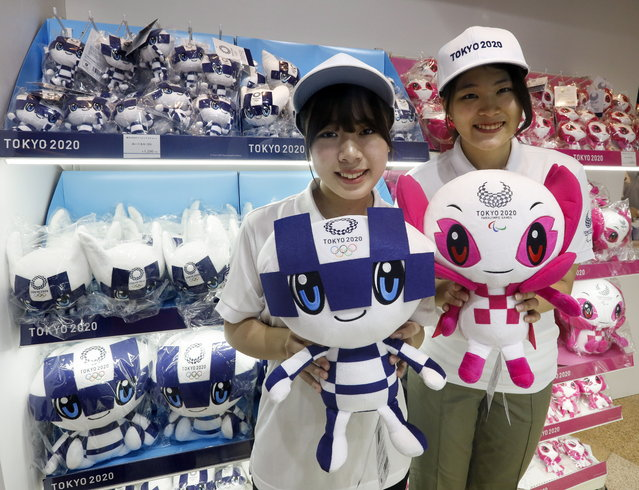Tokyo 2020 official mascot house staff promote for sale Olympics mascot Miraitowa (L) and Paralympics mascot Someity after the mascot made debut in Tokyo, Japan, 22 July 2018. Tokyo 2020 Olympics will start on 24 July 2020 and run until 09 August 2020. (Photo by Kimimasa Mayama/EPA/EFE)