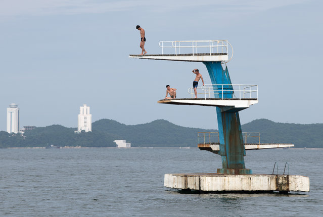 Men pause on a diving platform on August 22, 2018 in Wonsan, North Korea. (Photo by Carl Court/Getty Images)