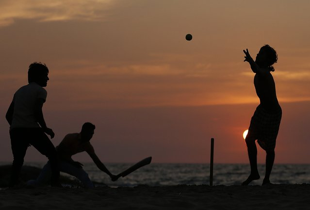 Youths play cricket on a beach in Colombo, Sri Lanka February 19, 2015. (Photo by Dinuka Liyanawatte/Reuters)