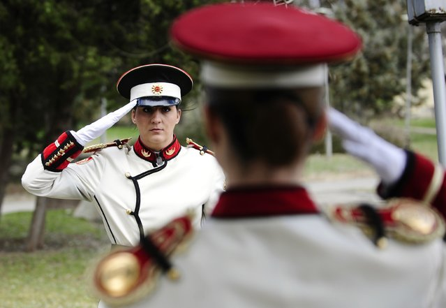 Corporals Verica Zlatevska (L) and Dragana Kitanovska attend an honour guard training session at an army barracks in Skopje March 4, 2015. Macedonia's honour army battalion, the ceremonial uniformed guard that receives every foreign president, dignitaries and delegations, but also sees off and welcomes the head of state every time he leaves the country, has a different glow. For the first time in the history of Macedonia's army, the honour guard has two women in its ranks. There has not been an event in which one of them is not in the first row. Zlatevska joined the army in 2003, Kitanovska in 2006. Picture taken March 4, 2015.   REUTERS/Ognen Teofilovski (MACEDONIA - Tags: MILITARY SOCIETY)