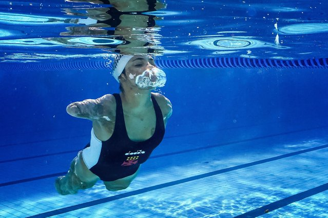 """Brazilian para athlete swimmer Jessica Oliveira, known as """"Jessyborg – the robot girl"""", trains at Vasco da Gama Club on June 02, 2021 in Rio de Janeiro, Brazil. Jessyborg is a 16-year-old base athlete at the Vasco da Gama club, tetra amputee and oral deaf as a result of meningitis meningococcal suffered at 10 years of age. Due to the disease, the athlete lost all four limbs, her hearing and part of her skin. Currently, she gives motivational talks, has just released a book and her big dream is to represent Brazil in a Paralympics Games. (Photo by Buda Mendes/Getty Images)"""