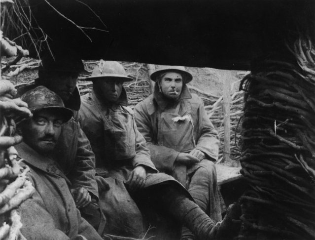 French and British troops in a trench on the Western Front during World War I, 1916. (Photo by General Photographic Agency/Getty Images)