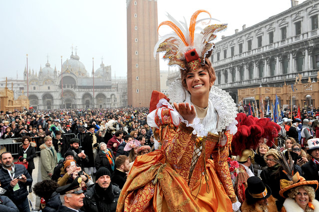 Irene Rizzi blows a kiss after descending from the bell tower into St. Mark's Square, in Venice, Sunday, January 31, 2016. (Photo by Luigi Costantini/AP Photo)