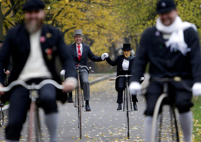 CZECH REPUBLIC: Participants wearing historical costumes ride their high-wheel bicycles during the annual penny farthing race in Prague, Czech Republic November 5, 2016. (Photo by David W. Cerny/Reuters)