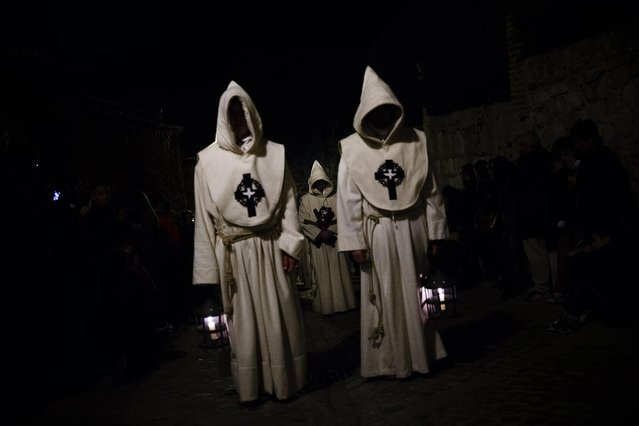 Penitents of the Santisimo Cristo del Espiritu Santo brotherhood take part in a Holy Week procession in Zamora, Spain, Friday, March 27, 2015. (Photo by Daniel Ochoa de Olza/AP Photo)