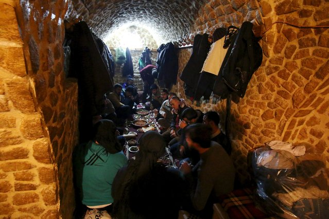 Customers eat after taking a steam bath at al-Salhiyeh traditional hammam, at a rebel-controlled area in the old city of Aleppo, Syria January 26, 2016. (Photo by Abdalrhman Ismail/Reuters)