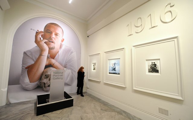 "A journalist attends the press preview for '""Vogue 100: A Century of Style"" exhibiting the photographs that has been commissioned by British Vogue since it was founded in 1916 at National Portrait Gallery on February 10, 2016 in London, England. (Photo by Stuart C. Wilson/Getty Images)"